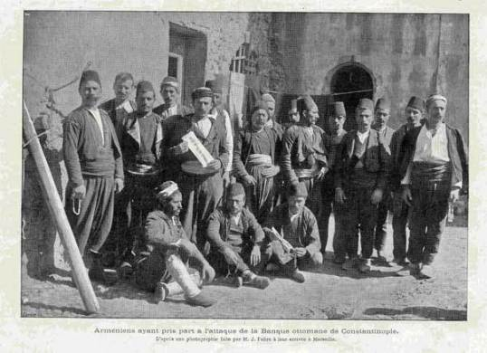 Surviving members of the takeover after they arrived in Marseille, France. On 26 August 1896, members of the Armenian Revolutionary Federation (Dashnak Party), armed with pistols, grenades, dynamite and hand-held bombs took over the Ottoman Bank for 14 hours. Resulting in the deaths of ten of the Armenian men and Ottoman soldiers followed by mob riots where 100's of people lost their lives. After fourteen hours of occupation and repelling government attempts to retake the bank, the Ambassadors of Europe, principally through the good offices of Russian consul Maxmiov, and the director of the bank, Sir Edgar Vincent (Lord of Abernon), succeeded in persuading the Armenian men to leave the bank, by promising to meet to their demands as well as grant them safe passage out of the bank. Sir Edgar's secretary, told that their action would alienate the European powers and cause a 'fearful massacre of Armenians' but they replied that if they died they would do so as martyrs and patriots. They were assured of a pardon and unhindered departure from the city on board Sir Edgar Vincent's private yacht.